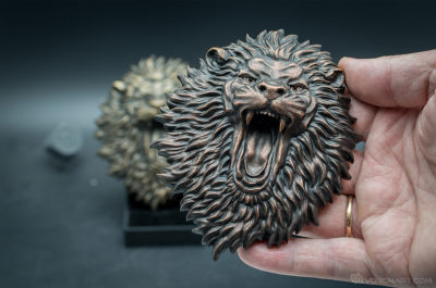 Buy Angry Lion face. Faux copper animal relief sculpture